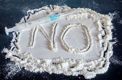 NO word write in white powder, black background, no drugs, close Royalty Free Stock Image
