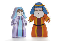 Noah and his wife. Wooden figures depicting Noah and his wife isolated against a white background Stock Photography