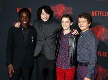 Noah Schnapp, Gaten Matarazzo, Caleb McLaughlin and Finn Wolfhard. At the Netflix`s season 2 premiere of `Stranger Things` held at the Regency Village Theatre Stock Images