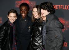 Noah Schnapp, Gaten Matarazzo, Millie Bobby Brown, Caleb McLaughlin and Finn Wolfhard. At the Netflix`s season 2 premiere of `Stranger Things` held at the Stock Photo