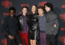 Noah Schnapp, Gaten Matarazzo, Millie Bobby Brown, Caleb McLaughlin and Finn Wolfhard. At the Netflix`s season 2 premiere of `Stranger Things` held at the Royalty Free Stock Photo