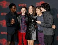 Noah Schnapp, Gaten Matarazzo, Millie Bobby Brown, Caleb McLaughlin and Finn Wolfhard. At the Netflix`s season 2 premiere of `Stranger Things` held at the Stock Photos