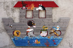 Noahs Ark Flood. Close-up of a model of Noahs Ark, fixed to a  wall in a children's playground. Made out of wooden boards painted with a variety of brightly Royalty Free Stock Photos