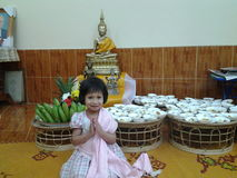 Nob as praying. Small girl try to pray for budhha Royalty Free Stock Image