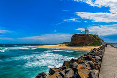 Nobby Beach in Newcastle NSW Australia. The first beach on the Bather`s Way, take a walk along the Harbour Break-wall and Nobby`s Lighthouse Royalty Free Stock Photo