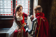 A Noble Betrothal. A young knight making the promise to his lady of heart Stock Image