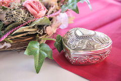 Noble box in heart shape. On a wedding table Royalty Free Stock Image