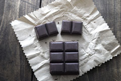 Noble dark chocolate on a wooden table. From above Stock Photos