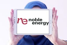 Noble Energy company logo. Logo of Noble Energy on samsung tablet holded by arab muslim woman. Noble Energy, Inc., formerly Noble Affiliates, Inc., is an Royalty Free Stock Images