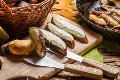 Noble forest mushrooms straight from the pan. On old wooden table Royalty Free Stock Photography