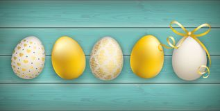 Noble Golden Easter Eggs Wooden Turquoise Header. Easter eggs on the wooden background Royalty Free Stock Images