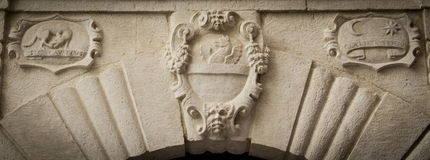 Noble heraldic symbol. On the entrance of house Stock Photography