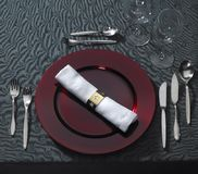 Noble place setting on dark tablecloth Royalty Free Stock Photo