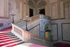 Noble Stairway. Red carpet on a marble stairway Royalty Free Stock Images