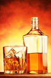 Noble whiskey in a glass and bottle Royalty Free Stock Images