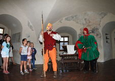 Nobleman Puta and soldier in Red Keep Stock Photos