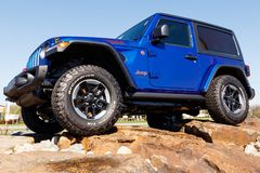 Jeep Wrangler on display at a Chrysler Jeep dealership. The subsidiaries of FCA are Chrysler, Dodge, Jeep, and Ram III. Noblesville - Circa April 2019: Jeep royalty free stock photography