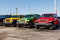 Jeep Wranglers on display at a Chrysler Jeep dealership. The subsidiaries of FCA are Chrysler, Dodge, Jeep, and Ram I. Noblesville - Circa April 2019: Jeep royalty free stock images