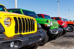 Jeep Wranglers on display at a Chrysler Jeep dealership. The subsidiaries of FCA are Chrysler, Dodge, Jeep, and Ram II. Noblesville - Circa April 2019: Jeep royalty free stock photo