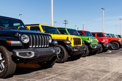 Jeep Wranglers on display at a Chrysler Jeep dealership. The subsidiaries of FCA are Chrysler, Dodge, Jeep, and Ram IV. Noblesville - Circa April 2019: Jeep royalty free stock photos
