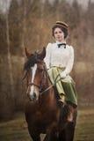 Noblewoman portrait on horse. Noblewoman horse riding in sidesaddle. Stylized portrait in XIX-XX century riding habit Stock Images