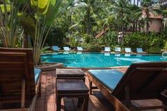 Nobody lounge chairs near swimming pool Stock Image