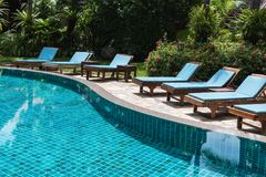 Nobody lounge chairs near swimming pool Stock Images