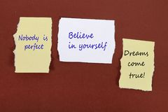 Nobody is perfect. Believe in yourself. Dreams come true! Note pin on the bulletin board. Nobody is perfect. Believe in yourself. Dreams come true!  Note pin on Royalty Free Stock Photo