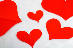 Nobody red hearts. On grey paper background Stock Photography