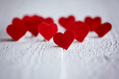 Nobody red hearts on the wooden background. Valentines day. Conc Stock Photos