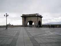 Nobody in the square at the top of the rampart with a predominan. Ce of gray cloudy sky in Cagliari Royalty Free Stock Photos