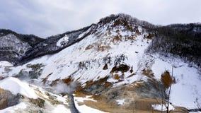 Noboribetsu onsen śnieżną zima krajobrazu piekła dolinę Fotografia Stock