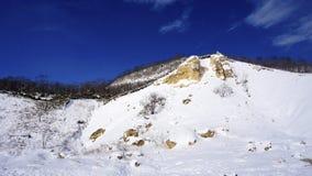 Noboribetsu onsen зима долины ада горы снега bluesky Стоковая Фотография RF