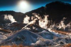 Jigokudani hell valley with sunrise. Noboribetsu scenics landmark, Jigokudani hell valley against sunrise and blue sky, Hokkaido, Japan Royalty Free Stock Photography