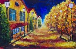 Noc koloru żółtego domy przy jesieni opustoszałą ulicą Latarnie uliczne Fotografia Royalty Free