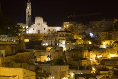 Noc widok historyczny miasteczko Matera, stawia czoło swój Duomo katedrę Zdjęcie Royalty Free