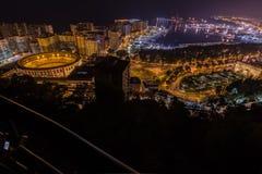 Noc widok Malaga z portem i Placa De Torros od kasztelu Zdjęcie Royalty Free