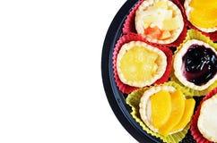 Noce di cocco arancio del toddy del mirtillo della pesca variopinta della torta di frutta per il partito Fotografie Stock Libere da Diritti