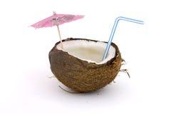 Noce di cocco con staw e il umbarella Immagini Stock