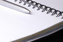 Noch-Lebensdauer mit Notizbuch. Lizenzfreies Stockfoto
