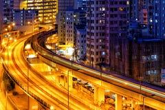 Noche ocupada del tráfico del tren de la carretera Imagen de archivo libre de regalías