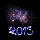 Nochevieja 2015 con los fuegos artificiales Foto de archivo libre de regalías