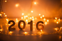 Nochevieja, 2016, luces, figuras hechas de la cartulina Imagen de archivo libre de regalías