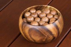 Noci di noce di macadamia Immagini Stock