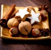 Noci, spezie e biscotti della cannella Fotografia Stock