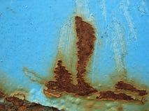 Nocivo e ruggine su fondo d'acciaio blu Fotografia Stock