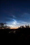 Noctilucent clouds at night sky Royalty Free Stock Photos