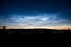 Noctilucent clouds at night sky Stock Image