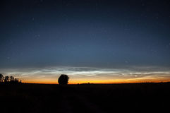 Noctilucent clouds in the night sky Stock Photo