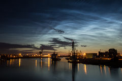 Noctilucent clouds and nightly port Royalty Free Stock Photography